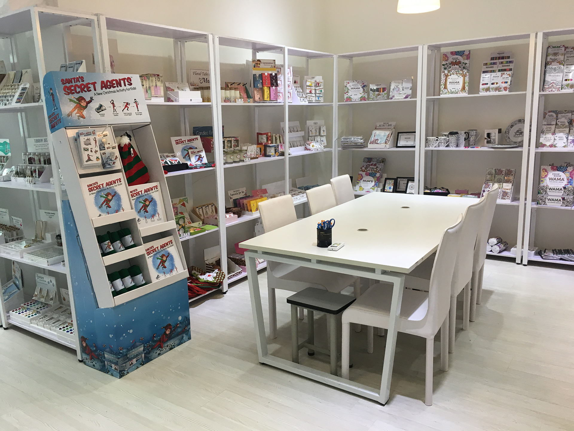 1000 Miles company showroom, featuring WAMA coloring books and Santa's secret agents