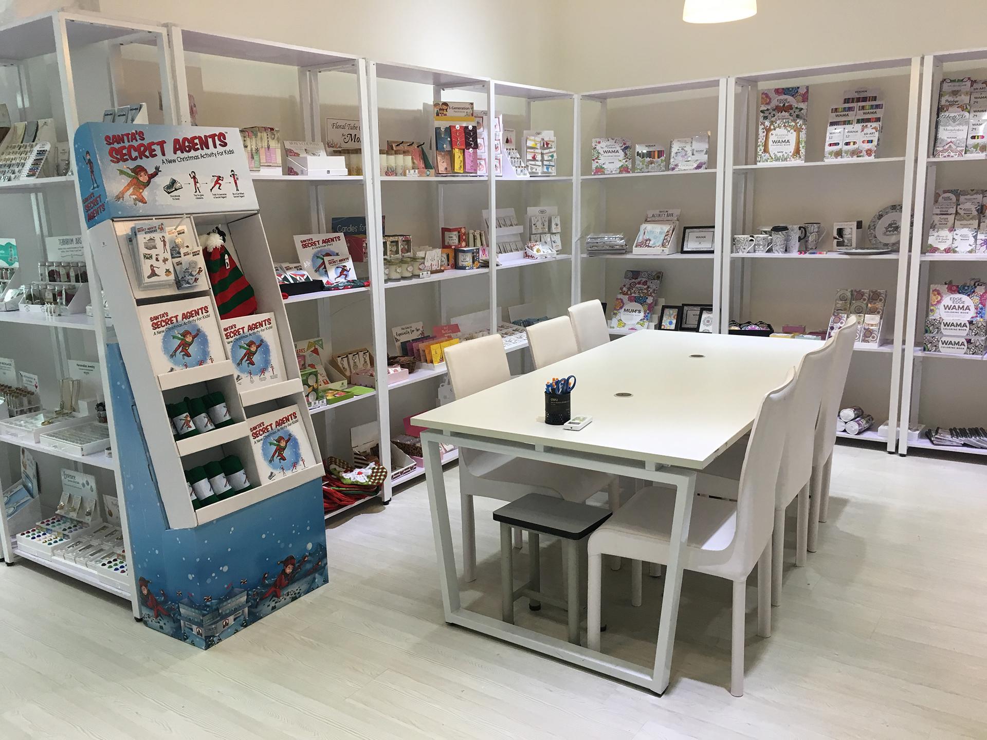 1000 Miles company showroom, featuring WAMA coloring books and Santa's secret agents